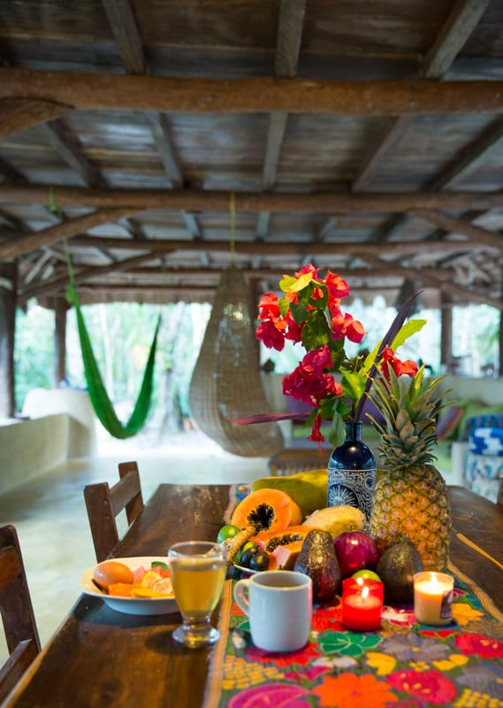 fresh tropical fruits and food on table in hut in Mexico