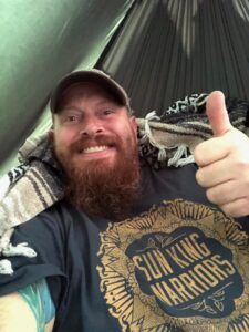 Josh Meeder hanging out in the Journeyman Hammock Camp